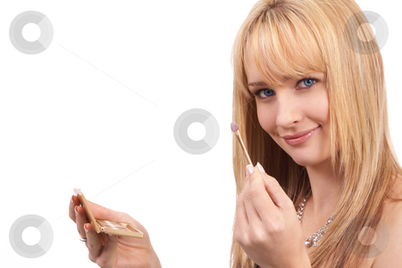 Portrait of beautiful blonde woman stock photo, Portrait of a beautiful blonde woman with light blue eyes applying make-up isolated on white background by Elena Weber (nee Talberg)