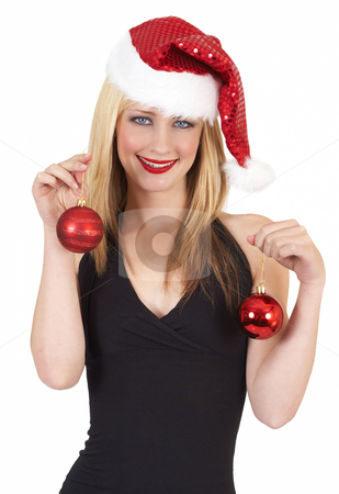 Portrait of beautiful blonde woman stock photo, Portrait of a beautiful blonde woman with light blue eyes and colorful make-up wearing red Christmas hat and baubles isolated on white background by Elena Weber (nee Talberg)