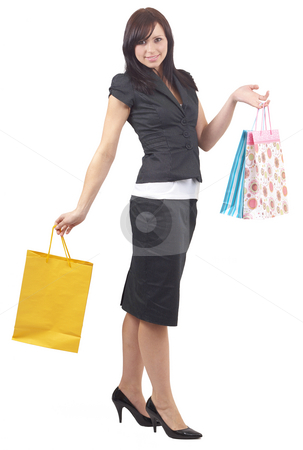 Portrait of beautiful brunette woman stock photo, Portrait of a beautiful young brunette woman wearing a fashionable suit with a skirt shopping, isolated on white background by Elena Weber (nee Talberg)