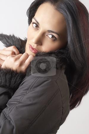 Portrait of beautiful brunette woman stock photo, Portrait of a beautiful mature brunette woman with dramatic make-up, wearing winter jacket with fur collar by Elena Weber (nee Talberg)