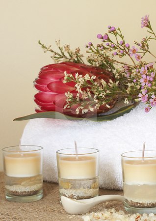 Relaxing spa scene stock photo, Relaxing spa scene with a white rolled up towel, protea and pink flowers, beautiful handmade candles and bath salts by Elena Weber (nee Talberg)