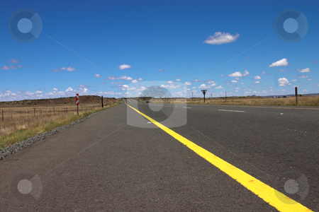 The road. stock photo, The road to nowhere on a sunny summer day. Freshly painted lines on the tar. by Elena Weber (nee Talberg)
