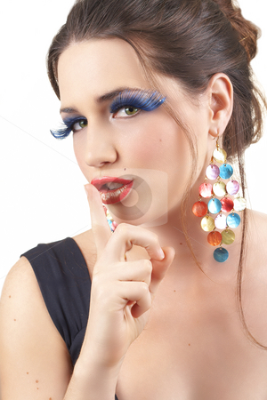 Portrait of beautiful brunette woman stock photo, Portrait of a beautiful young brunette woman with dramatic glamour make-up and fashionable earrings holding finger to her lips by Elena Weber (nee Talberg)