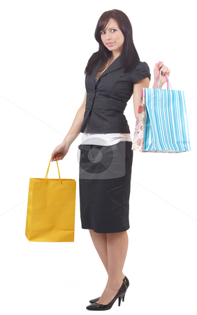 Portrait of beautiful brunette woman stock photo, Portrait of a beautiful young brunette woman wearing a skirt suit and holding shopping bags. Isolated on white background by Elena Weber (nee Talberg)