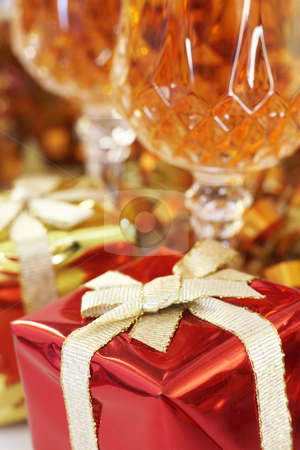 Colorful Christmas gifts stock photo, Colorful Christmas gift boxes with ribbons, golden tinsel and two glasses of sherry. Shallow depth of field by Elena Weber (nee Talberg)