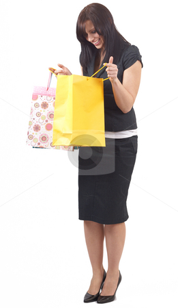 Portrait of beautiful brunette woman stock photo, Portrait of a beautiful young brunette woman wearing a skirt suit looking inside shopping bags with excitement. Isolated on white background by Elena Weber (nee Talberg)
