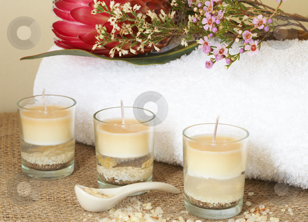 Relaxing spa scene stock photo, Relaxing spa scene with a white rolled up towel, red protea, beautiful handmade candles and bath salts by Elena Weber (nee Talberg)
