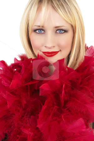 Portrait of beautiful blonde woman stock photo, Portrait of a beautiful blonde woman with light blue eyes and dramatic make-up wrapped in red feather boa isolated on white background by Elena Weber (nee Talberg)