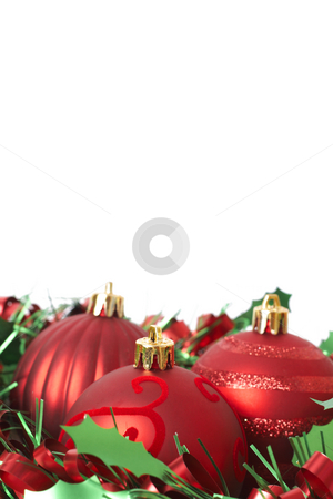 Red Christmas baubles and tinsel stock photo, Three red Christmas baubles with green tinsel isolated on white background with copy space. Shallow depth of field by Elena Weber (nee Talberg)