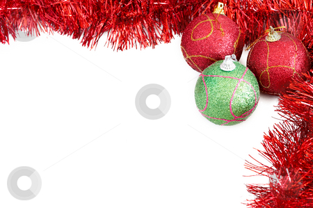 Three Christmas baubles with red tinsel stock photo, Three red and green Christmas baubles with red tinsel forming a frame on white backgound by Elena Weber (nee Talberg)