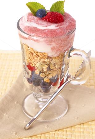 Healthy breakfast with muesli and yoghurt stock photo, Healthy breakfast with muesli, raspberries, blueberries and yoghurt, decorated with mint leaves in a glass by Elena Weber (nee Talberg)