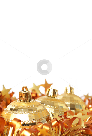 Gold Christmas baubles in tinsel stock photo, Three gold Christmas baubles in yellow tinsel isolated on white background with copy space. Shallow depth of field by Elena Weber (nee Talberg)