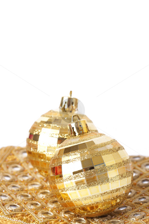 Two gold Christmas baubles on pretty material stock photo, Two gold Christmas baubles on pretty golden material isolated on white background with copy space. Shallow depth of field by Elena Weber (nee Talberg)