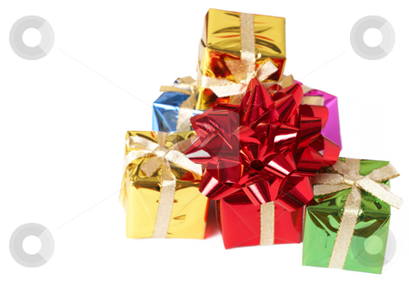 Stack of gift boxes and bow on white stock photo, Stack of small colorful gift boxes and red bow isolated on white background with copy space by Elena Weber (nee Talberg)