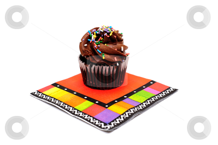 Chocolate Cupcake stock photo, Single cupcake with chocolate frosting and colorful sprinkles on top of a brightly colored party napkin isolated on white by Lynn Bendickson