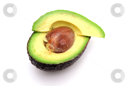 Sliced Avocado stock photo, Avocado cut in half exposing the single seed and the various shades of green in the fruit by Lynn Bendickson