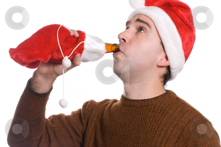 Christmas Alcohol stock photo, A young man drinking alcohol which is wrapped in a red sack, isolated against a white background by Richard Nelson