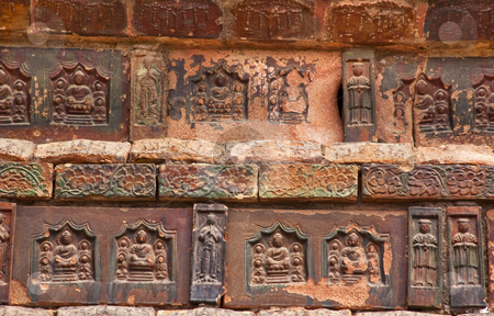 Ancient Bricks Details Iron Buddhist Pagoda Kaifeng China stock photo, Ancient Bricks Buddhas Dancers Chinese Officials Iron Pagoda Buddhist Monument Kaifeng China Built in 1069 by the Kaibao Buddhist Monastery.  Best example of glazed brick pagoda in China by William Perry