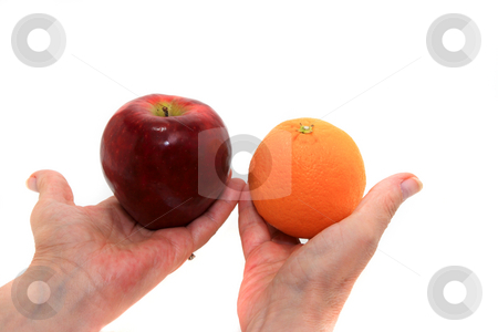 Fruit Offering stock photo, Apple and oranges on female hands by Jack Schiffer