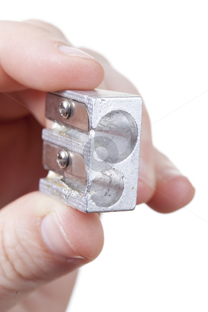 Isolated pencil sharpener stock photo, Hand with a pencil sharpener isolated over a withe background by Ivan Montero
