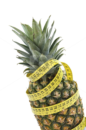 Pineapple with measuring tape. stock photo, Pineapple with measuring tape isolated over white. Diet concept. by Liana Bukhtyyarova