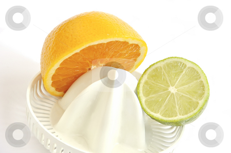Juicer with slices of orange and lime. stock photo, Juicer with slices of orange and lime isolated over white. by Liana Bukhtyyarova