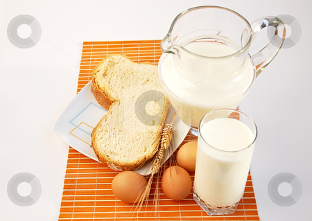 Pitcher of milk, wheat, bread and eggs.  stock photo, Pitcher of milk, wheat, bread and eggs. by Liana Bukhtyyarova