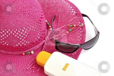 Beach hat, bottle of balm solar and glasses on white.  stock photo, Pink beach hat, bottle of balm solar and sun glasses on white. Summer's theme. by Liana Bukhtyyarova