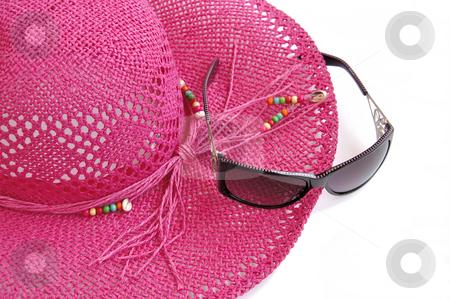 Beach hat and glasses on white.  stock photo, Pink beach hat and sun glasses isolated over white. Holiday?? by Liana Bukhtyyarova