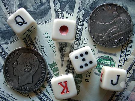 Playing Bones, Dollars and Ancient Coins. stock photo, Playing bones, dollars and ancient coins on background of dollars. by Liana Bukhtyyarova