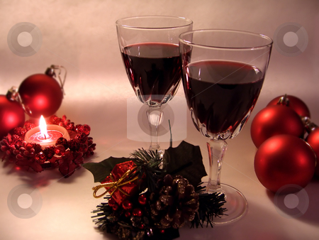Christmas decoration.  stock photo, Two glasses of red wine,  christmas decorations and burning candle. by Liana Bukhtyyarova
