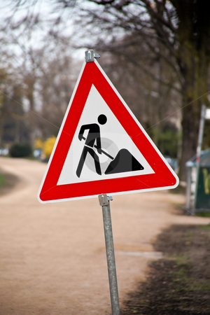 Construction Road Sign stock photo, Construction road sign with construction site in the background. Vertical. by Erwin Johann Wodicka