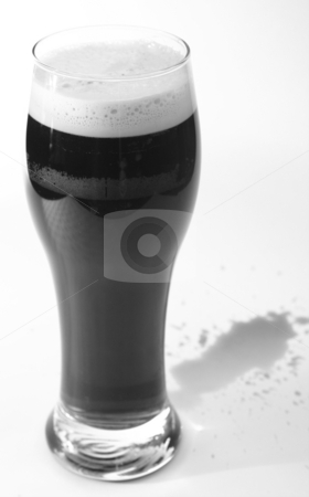 Beer glass of bitter stock photo, Pint of beer. a glass of stout or bitter on white background by Tracy lorna Nors