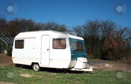 Caravan camping holiday stock photo, Caravan parked at caravan or camping site. white leisure home on lawn by Tracy lorna Nors