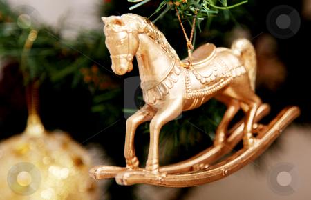Horse stock photo, Gold horse ornament on christmas tree. Xmas image by Giuseppe Ramos
