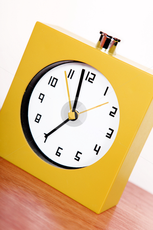Clock stock photo, Yellow clock over wooden surface and white background by Giuseppe Ramos