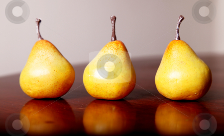 Fruit image stock photo, Three yellow pears on wooden surface. fruits by Giuseppe Ramos