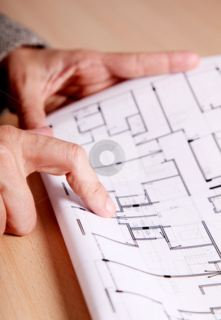 Architecture and engineering stock photo, Hand of a woman pointing to some architectural drawings by Giuseppe Ramos