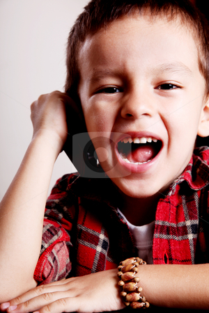 Child stock photo, Child talking on a cell phone and smiling by Giuseppe Ramos