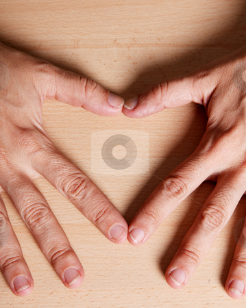 Hearth stock photo, Two hands forming a heart. Love image by Giuseppe Ramos