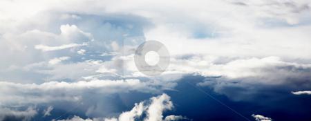 Blue sky stock photo, A sky with clouds and  sun light by Giuseppe Ramos