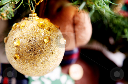 Gold sphere stock photo, Gold christmas ball on tree. Holiday image by Giuseppe Ramos