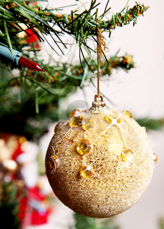 Christmas ball stock photo, Golden ball hanging on the Christmas tree by Giuseppe Ramos