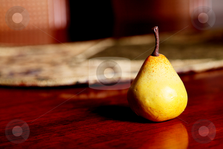 Pear stock photo, A yellow pear on wooden surface. Fruit image by Giuseppe Ramos