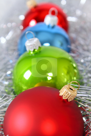 Four fur-tree toys in a tinsel stock photo, Four fur-tree toys in a tinsel removed close up by Andrey Efremov