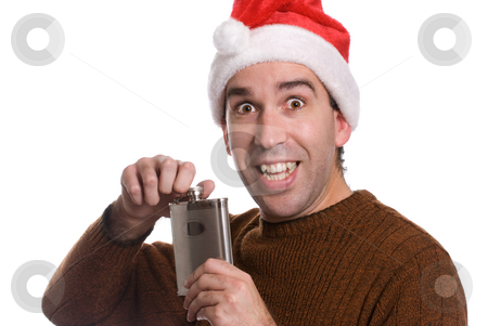 Christmas Alcohol stock photo, A young man smiling and holding a flask of alcohol, isolated against a white background by Richard Nelson