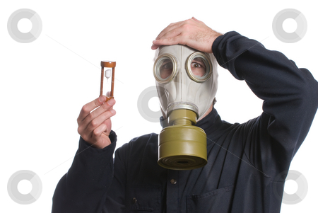 Running Out Of Time stock photo, Concept image of the environment running out of time featuring a man wearing a gas mask holding an hour glass, isolated against a white background by Richard Nelson