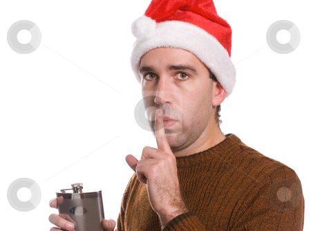 Drunk Christmas stock photo, A young man wearing a santa hat is holding an alcohol flask and covering his lips with his finger, isolated against a white background by Richard Nelson