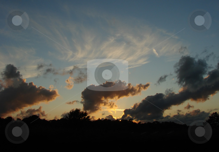 Evening Sky stock photo, Evening Sky with clouds and reflected setting sun in Sussex, England by Susan Robinson