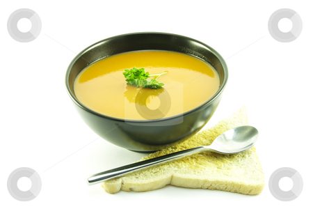 Tomato Soup in a Black Bowl stock photo, Rich red deliicious tomato soup in a small round black bowl with a sprig of parsley, toast and a spoon on a white background by Keith Wilson
